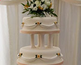 Traditional wedding cake with iced swags